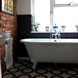 Kelly's bathroom in Parquet Charcoal by Neisha Crosland