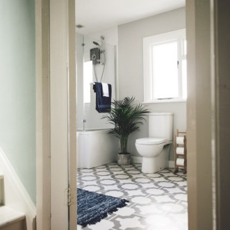 Mel's bathroom in Parquet Stone by Neisha Crosland