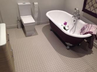 Rosie's bathroom in Spot Stone by Cath Kidston