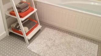 Bathroom with grey spotted flooring