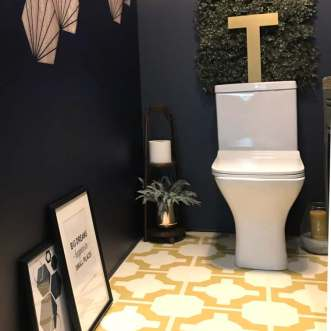 Parquet Mimosa is pictured here in a fun, creative bathroom. The colours pair well with the Navy walls.
