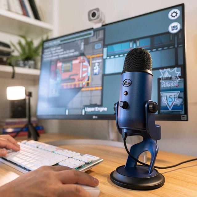 Blue mic on desk