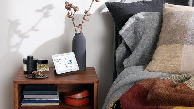 Google Hub sitting on bedside table