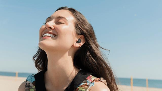 Woman wearing JBL Live Free Noise Cancelling TWS In-Ear Headphones