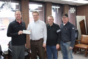 From left to right: Heartland CFO Mike Malone, Plankinton Development Board President Ron Kristensen, Heartland Customer Relations Manager Steve Moses, and Plankinton Light Superintendent Vern Hill