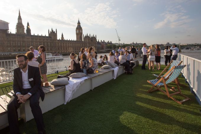 rooftop on boat sailing on Thames