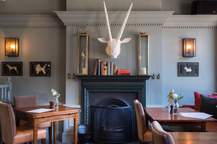 A modern and contemporary function room in a London pub. With blue walls and modern interiors.