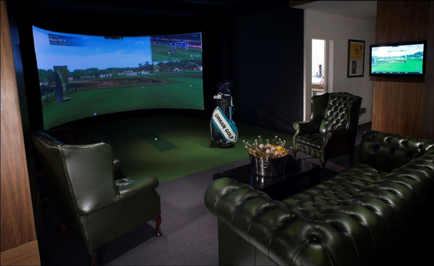 Urban Golf is one of the best unusual party venues London. The 160 degree simulator screen is on the back wall and three large, dark green, chesterfield chairs surrounded the screen. In the middle there is a bucket of beer and a golf clubs in their back.