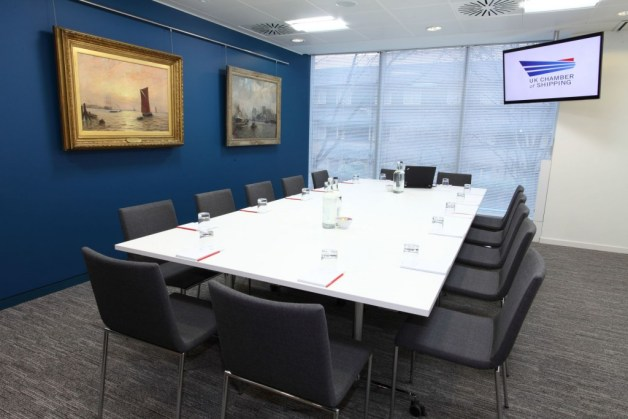 small blue walled meeting room