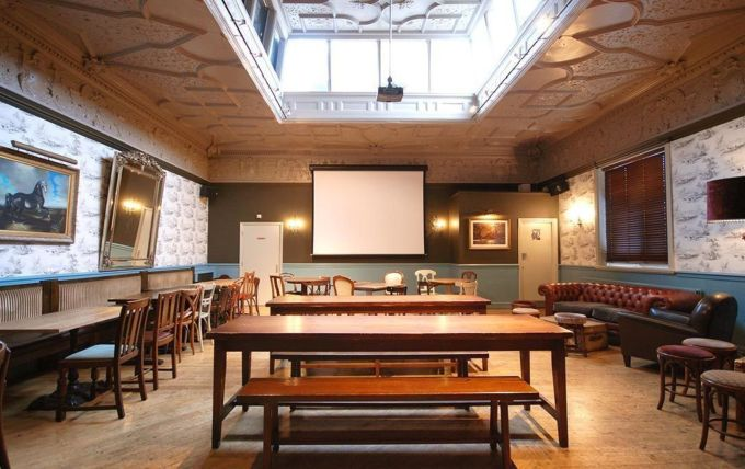 A traditional pub with private room in London. The room has a giant skylight that floods the space with natural light.