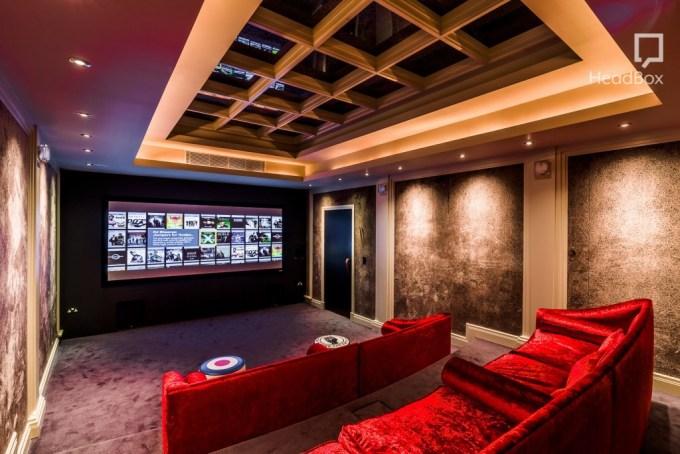 large room velvet sofas facing screen