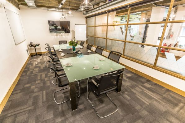 A large meeting room with a black and white table