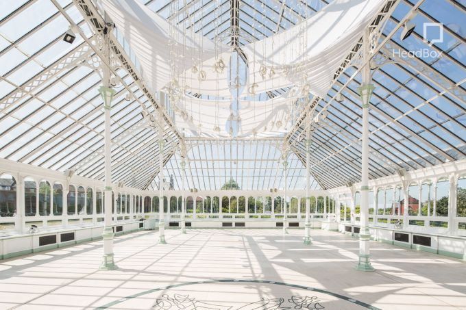 Victorian conservatory with blue sky backdrop