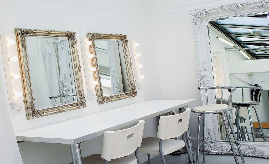 small white studio with two mirrors
