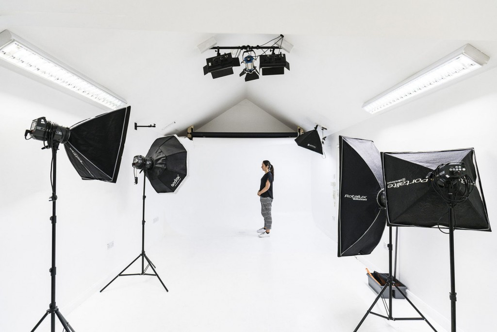 large white studio with black equipment