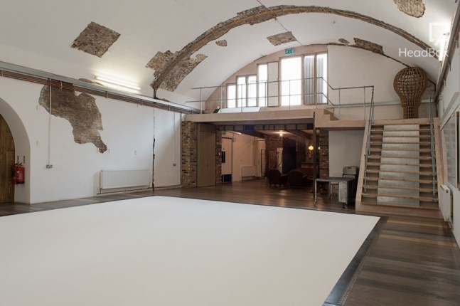 large studio with curved ceiling