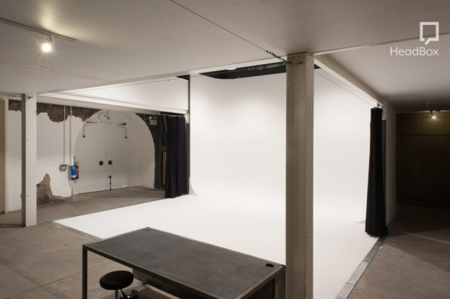 A studio with a white backdrop.