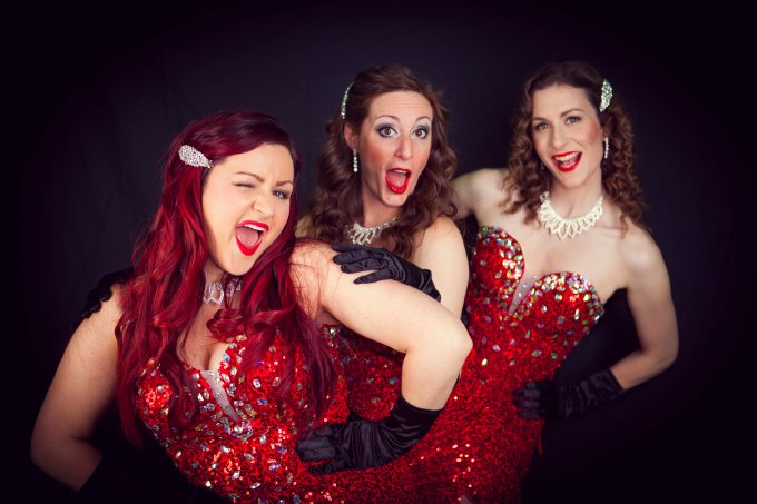 three red dressed women, The Dazzlettes