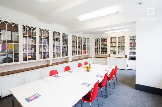 meeting room lined with bookcase cabinets