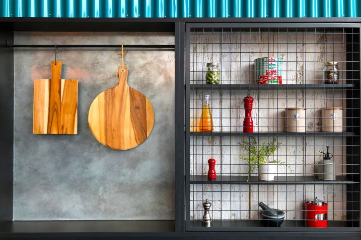 Two wooden chopping boards hanging