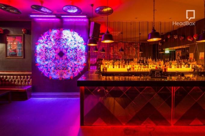red, orange and purple lit bar