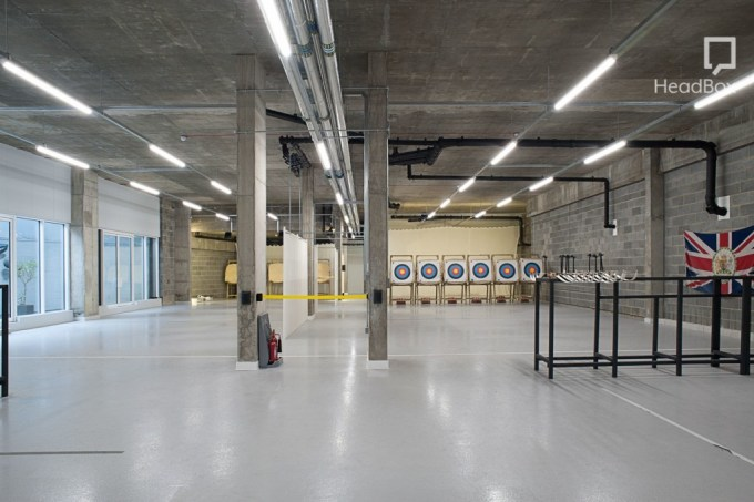 grey empty room with archery targets