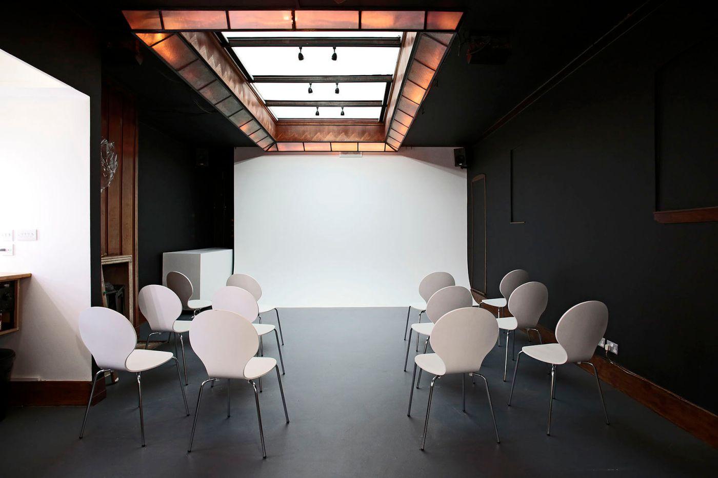 anomalous photography studio with white backdrop