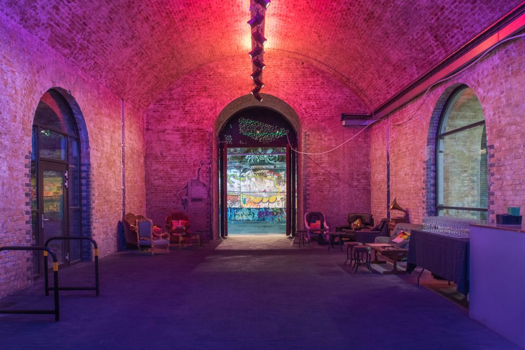 Large event space in Shoreditch with exposed brick walls and arched doors