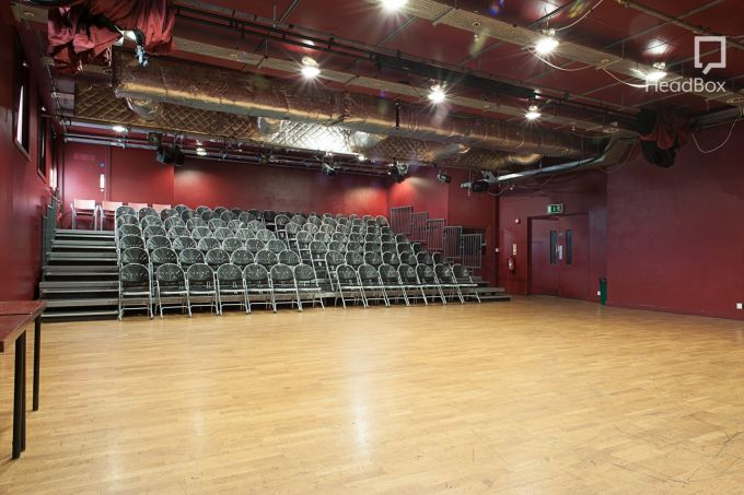 red walled and wooden floored auditorium