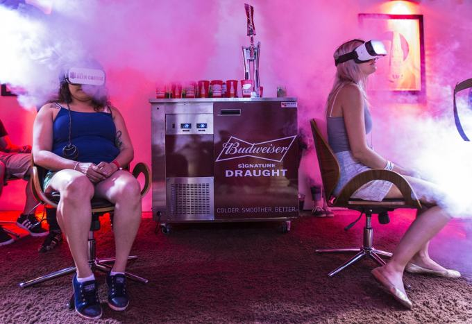 two people wearing VR headsets