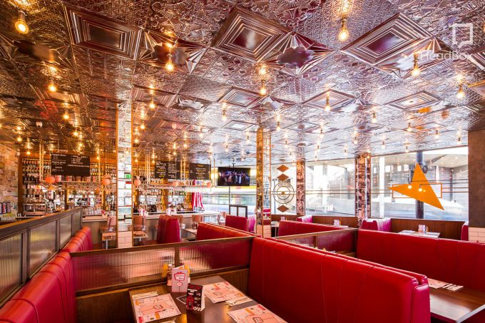 restaurant with golden aztec inspired ceiling