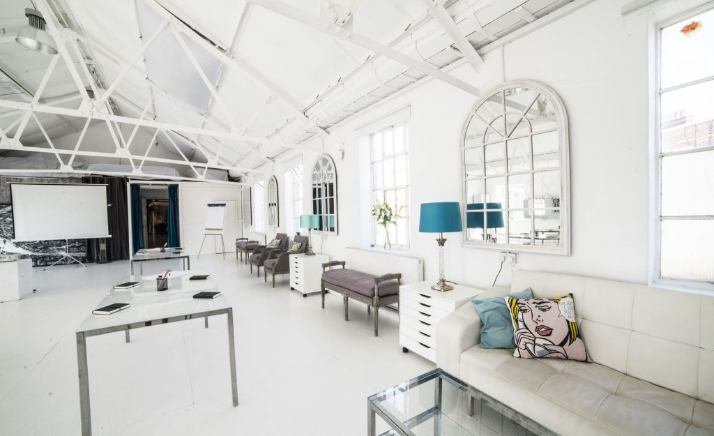loft with white and blue furnishings