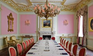A large meeting room with pink walls at the Ritz