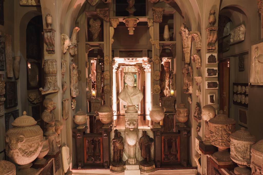 Room with museum artefacts.