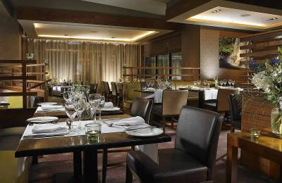 Restaurant with beige light fixtures and leather seating