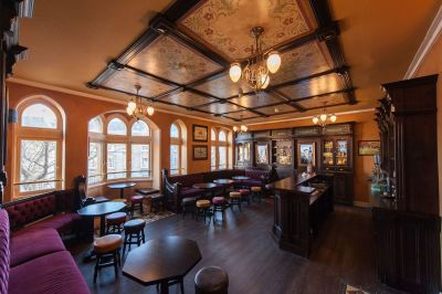 Bar space with old-style interiors and red velvet seating