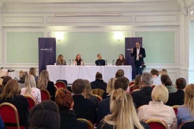 panel event with audience looking at four panellists