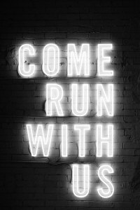 A neon sign spelling out 'Come run with us'