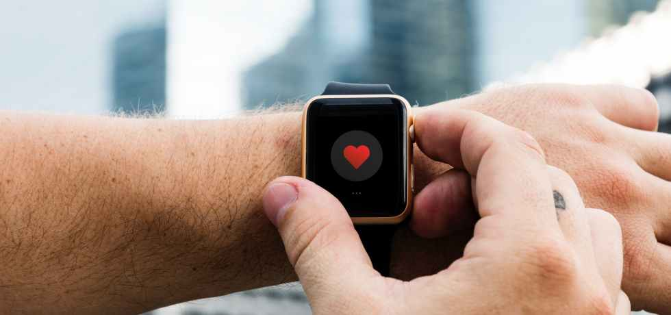 Person using their smartwatch to support their health