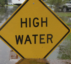 High Water Sign in Flooded Neighborhood