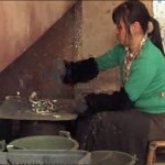 Woman cooking e-waste in China