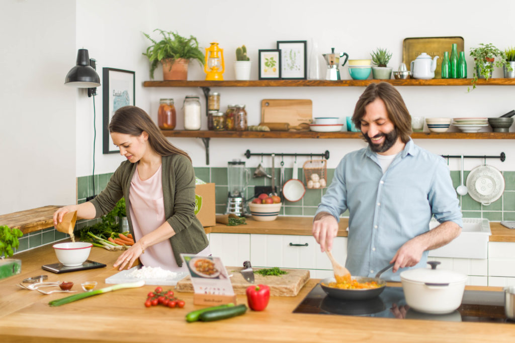 Two people cooking in the kitchen allows multi-tasking
