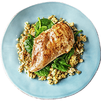 Harissa Chicken with Rustic Hummus Smash and Baby Spinach Leaves