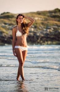 Girl with bikini walking in shallow water
