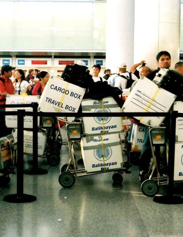 Some OFWs choose to bring their balikbayan boxes with them when flying back to home