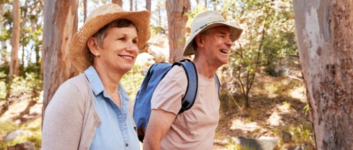 Middle aged couple on a hike getting some exercise