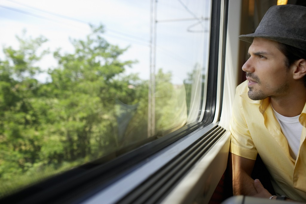 Man looking out of the train window