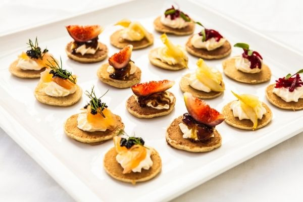 Blinis with Smoked Salmon and other toppings Warm or cold Blinis with Smoked Salmon and other toppings served with a variety of toppings, together with a bottle of wine or champagne, is utter bliss