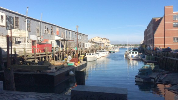 Portland waterfront. New condominiums and historic maritime businesses on facing wharves.