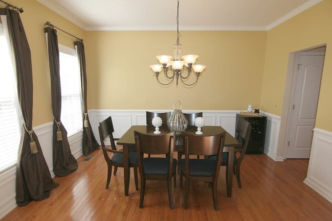 Dining room table with hanging light fixture.